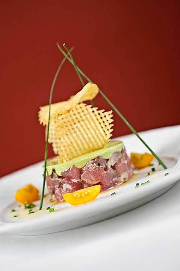 Tuna tartare with avocado mousse, capers, lemon, olive oil and pommes gaufrettes