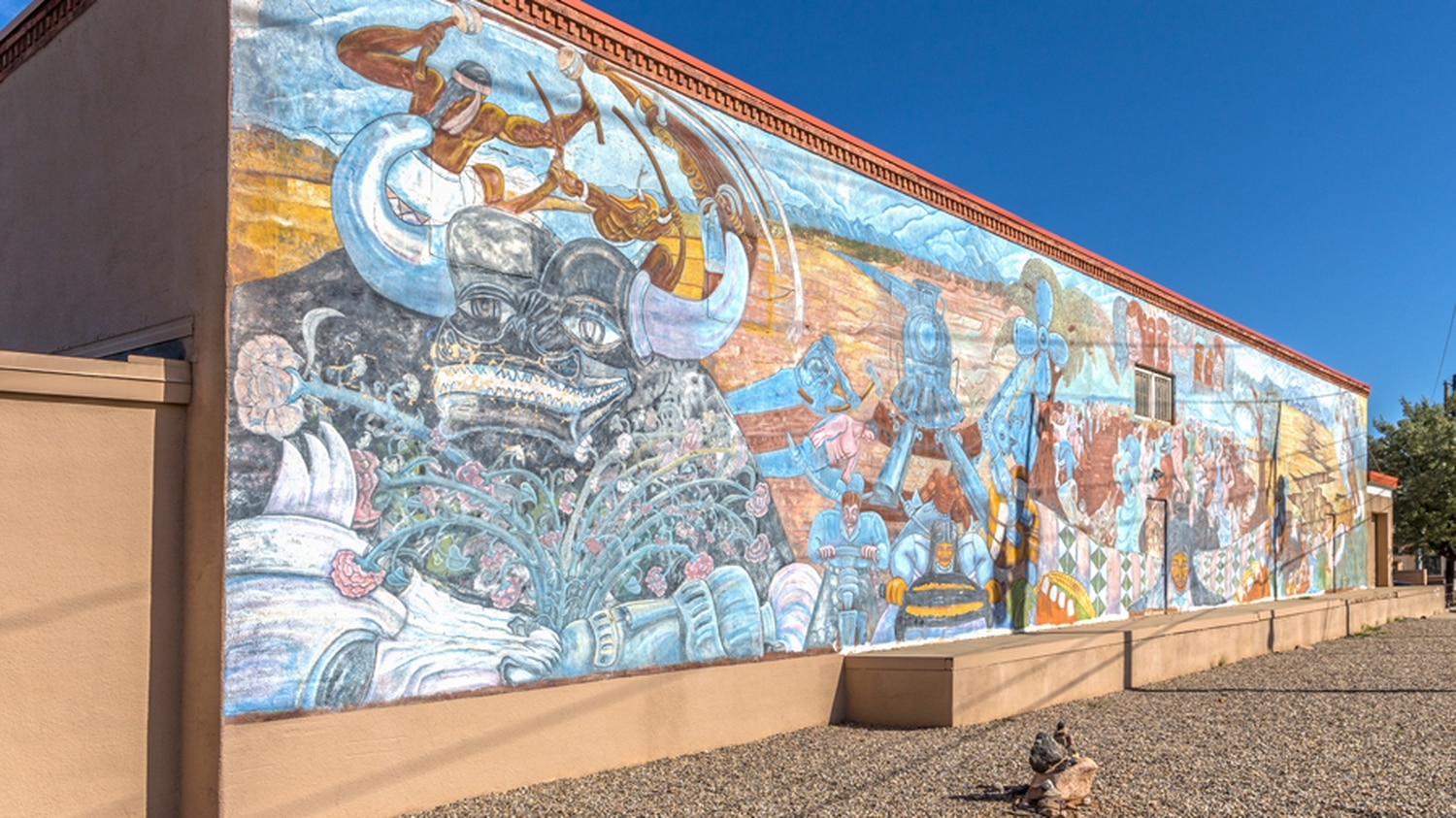The 1930s Halpin Building and its 1980s mural today from Guadalupe Street.