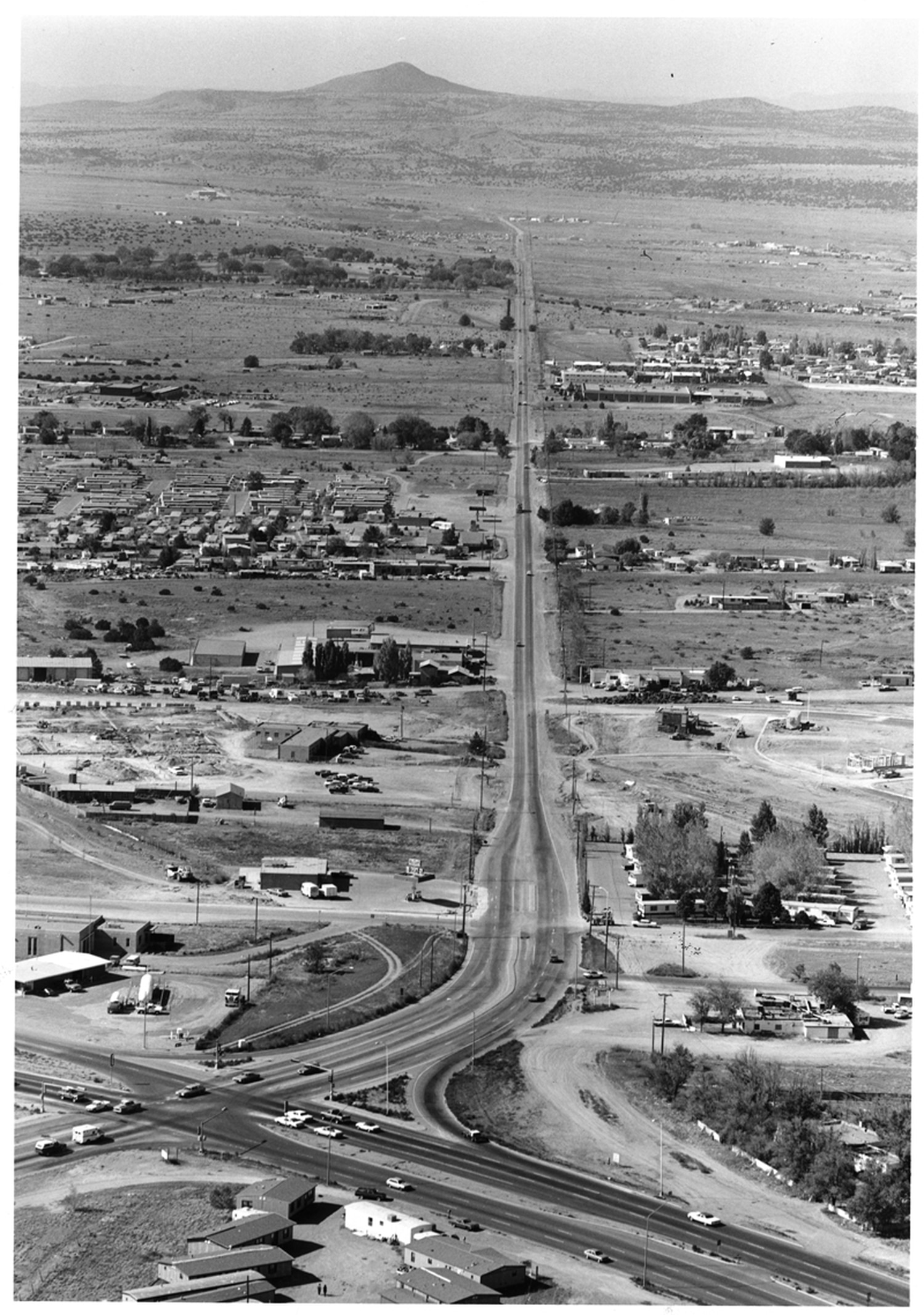Remember when Airport Road looked more like this aerial photo from 1983? At bottom left is the intersection with Cerrillos Road.