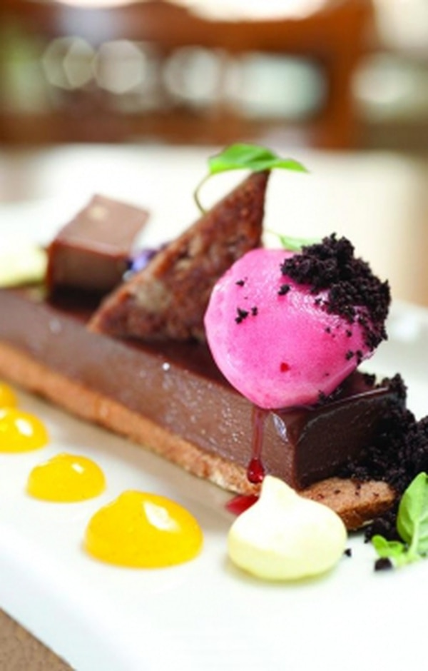 Milk chocolate and peanut butter tart with hibiscus sorbet and dried meringue Photo: Joy Godfrey