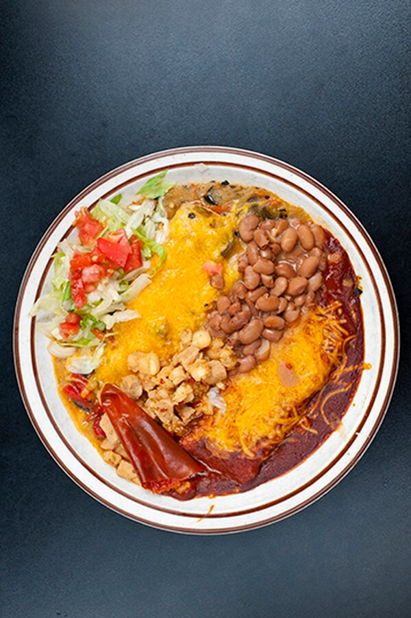 Enchiladas topped with Christmas-style chile with beans and posole