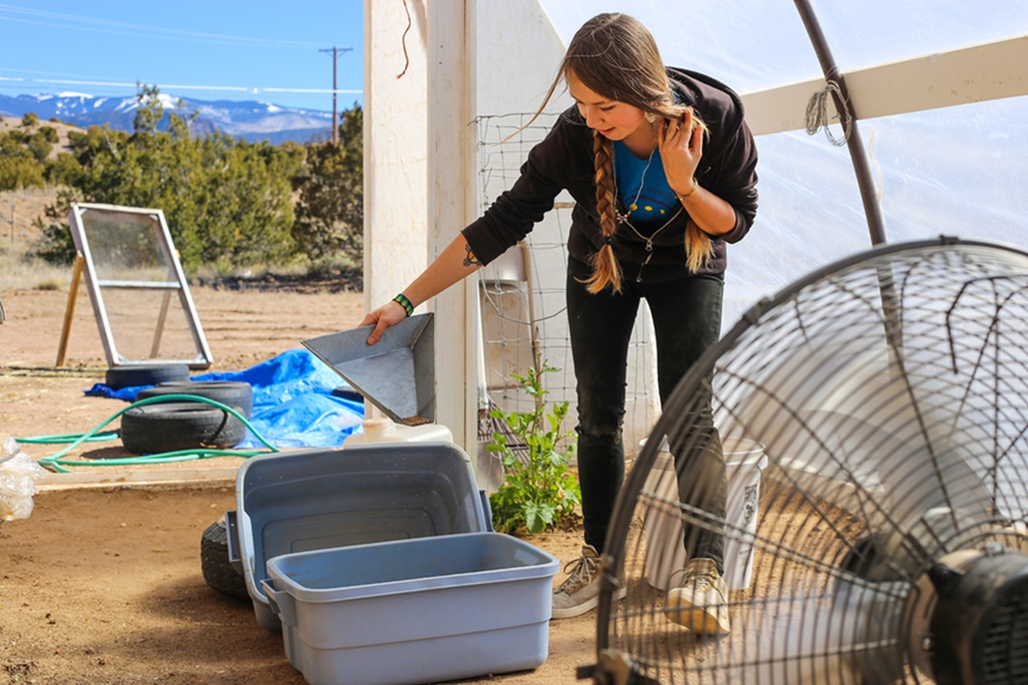 Emily Arasim demonstrates a seed sorting technique using wind—or, in this case, a fan.