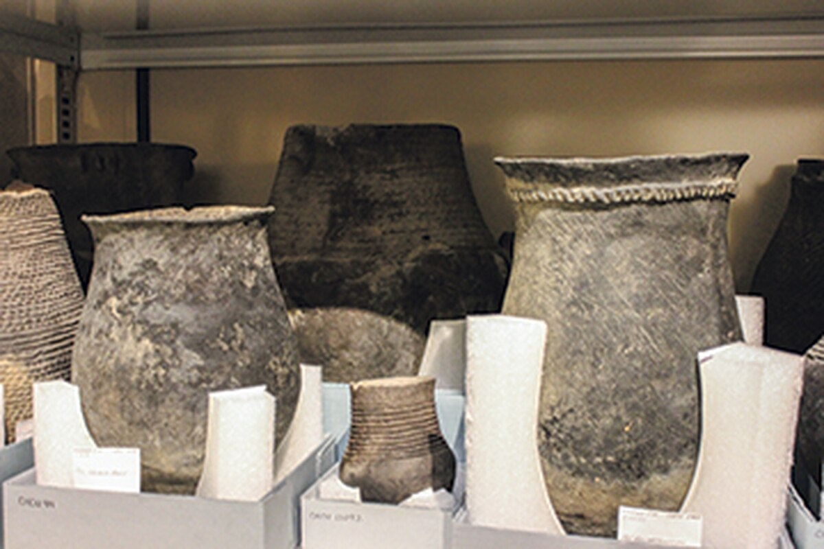 Pots like these that were excavated from the site will stay in the basement for now.