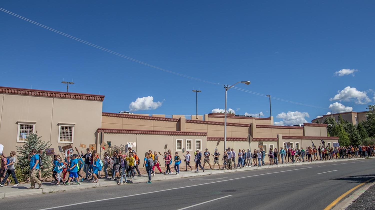 A group of students march to the the Oil and Gas Association.