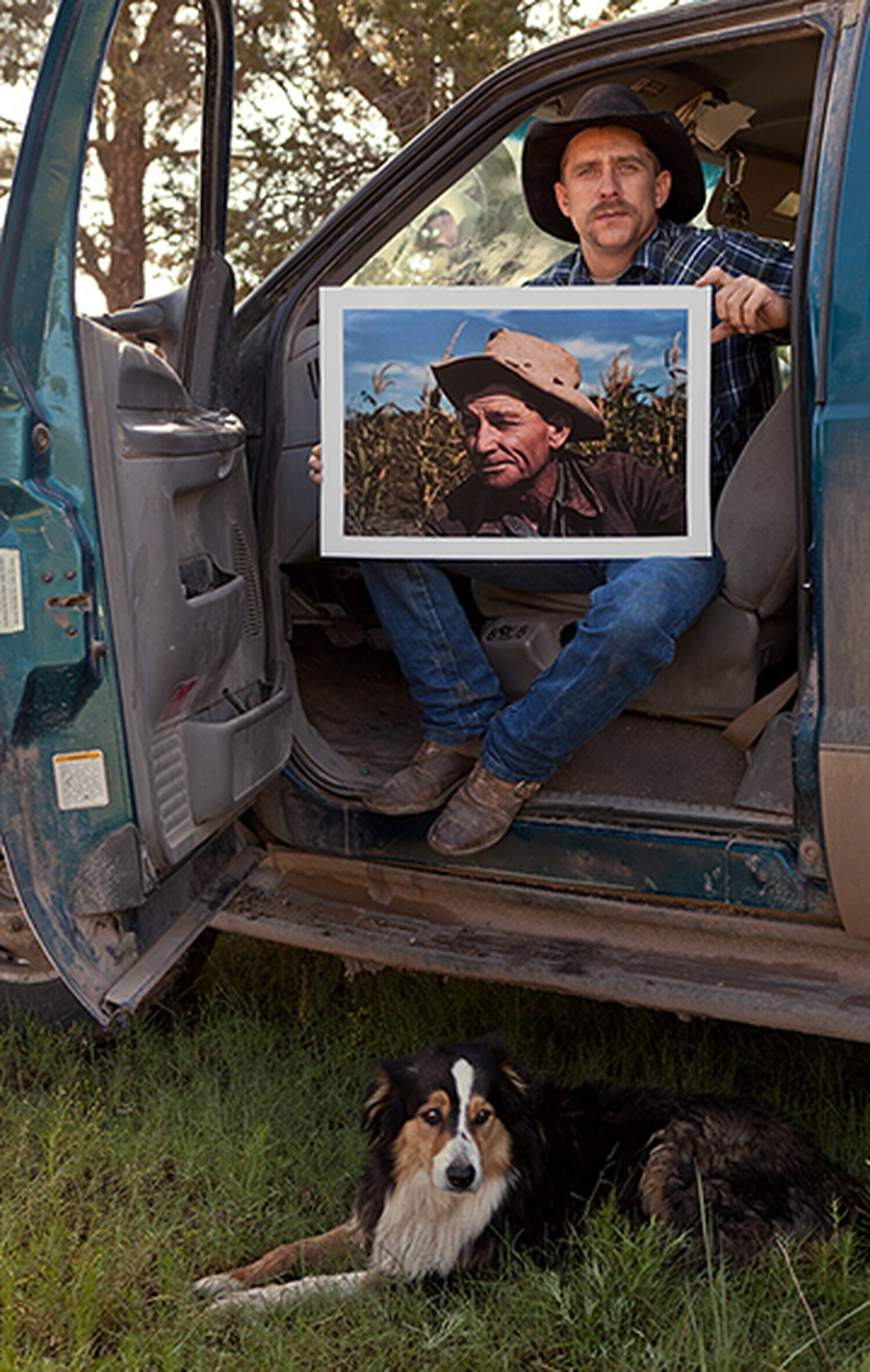 Rex Collins Norris Jr. holds a Russell Lee photo of his grandfather, Sam Norris.
