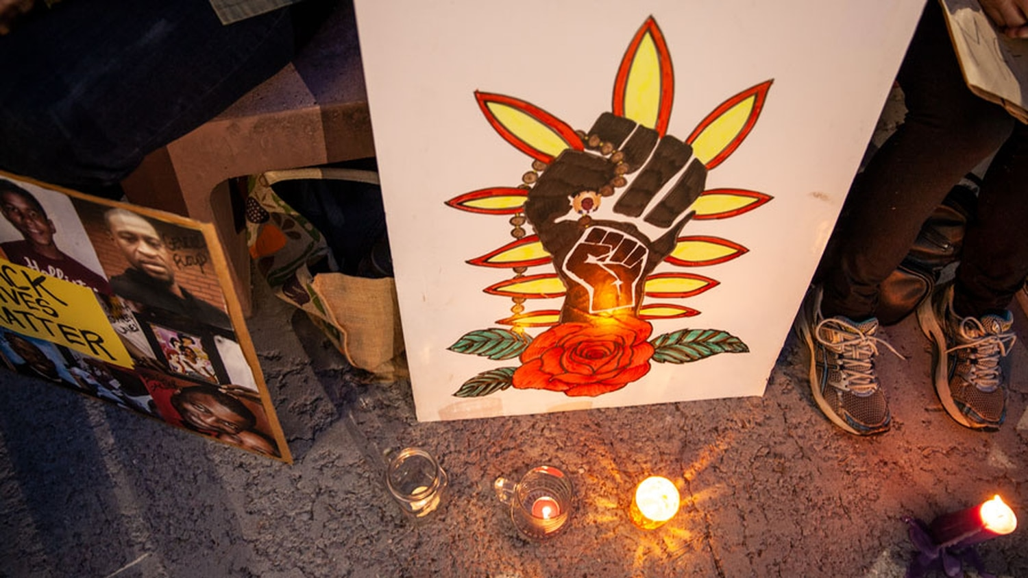 A New Mexican-inspired sign at Sunday's vigil.