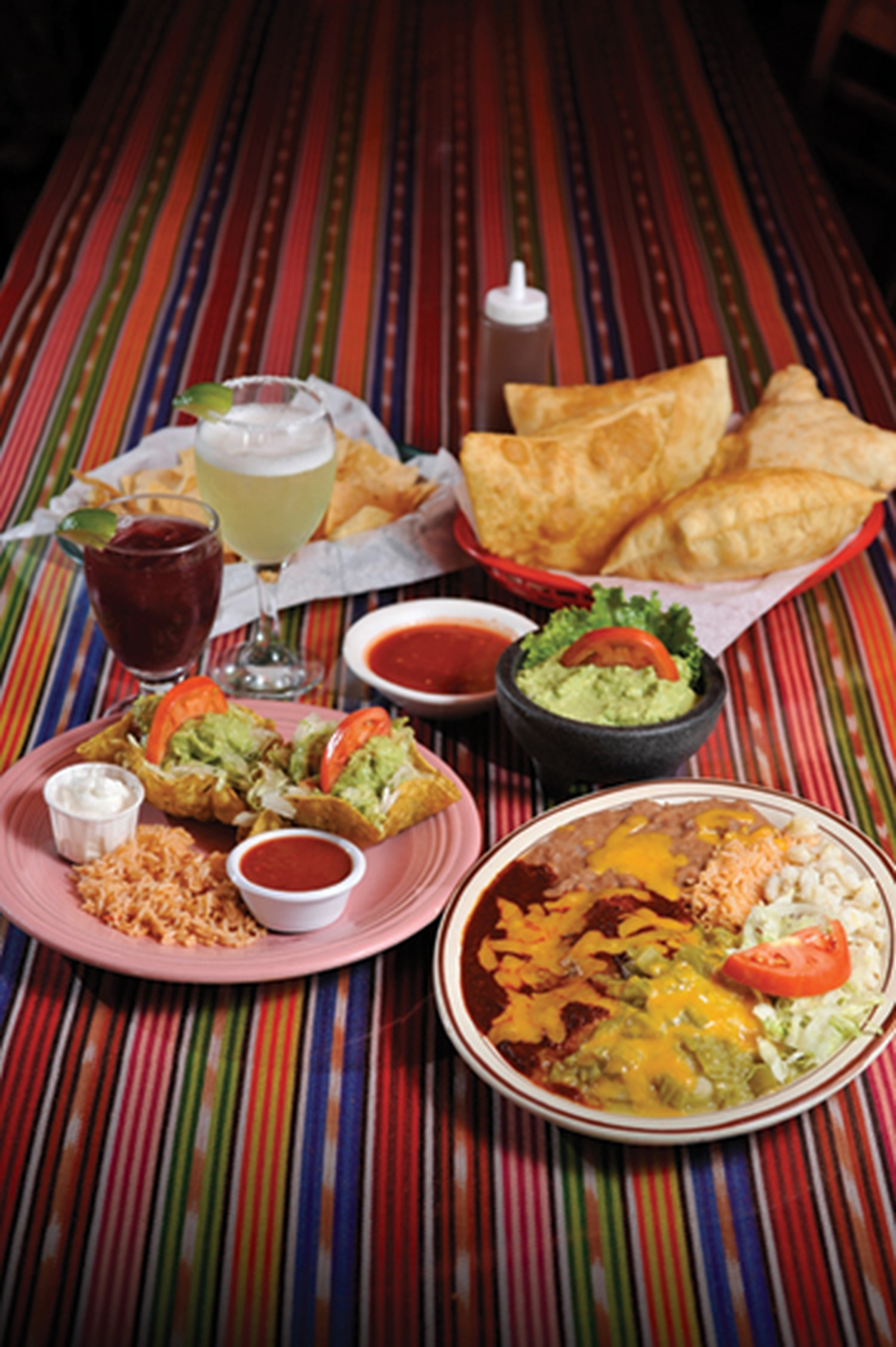 "Chicken enchilada with rice, beans and posole; beef chalupas with sour cream, salsa and rice. 2811 Cerrillos Road, 473-5800 Breakfast, lunch and dinner daily Café Castro There are many factors that propelled Café Castro to our Top 10. The expert nod to Northern New Mexico cuisine, their attentive service and the fact that a sign on one of its windows alerts to overflow parking available at neighboring Cheeks. Any given day, co-owner Julia Castro can be seen taking orders on the phone, bussing tables or working the cash register. Chips and salsa are de rigueur and, at only 3 bucks, an addiction in the making. Ballers should opt for ""El Trio Sabroso"" ($8.50), which also adds guac and queso to the mix. Local fare is where it's at here, and even diners who go at it eenie, meenie, miney, mo-style on the menu won't be disappointed. Try ""El Plato Grande""—a heaping plate that, true to its name, is a feast on a plate, boasting a chile relleno, a pork tamal, a cheese enchilada—salivating yet?—beans, refried beans and posole that'll make it rain on your tastebuds. -EL"
