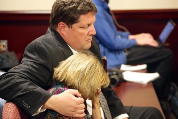 Attorney Mike Jones hugs Jane Griego as a judge reads the verdict.