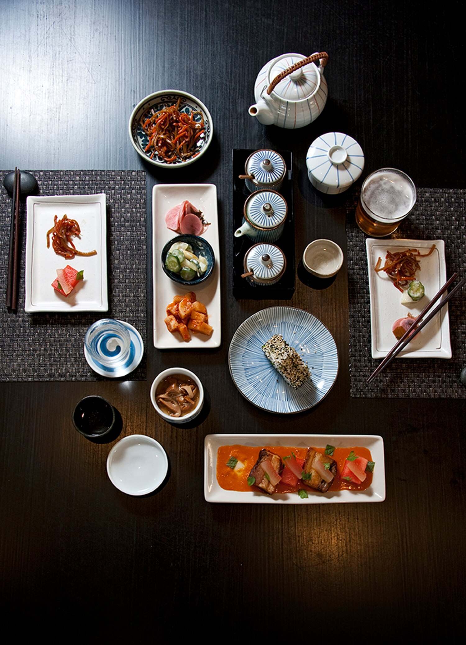 Bottom to top: Pork belly kakuni with watermelon; onigiri; pickle selection; kinpira gobo