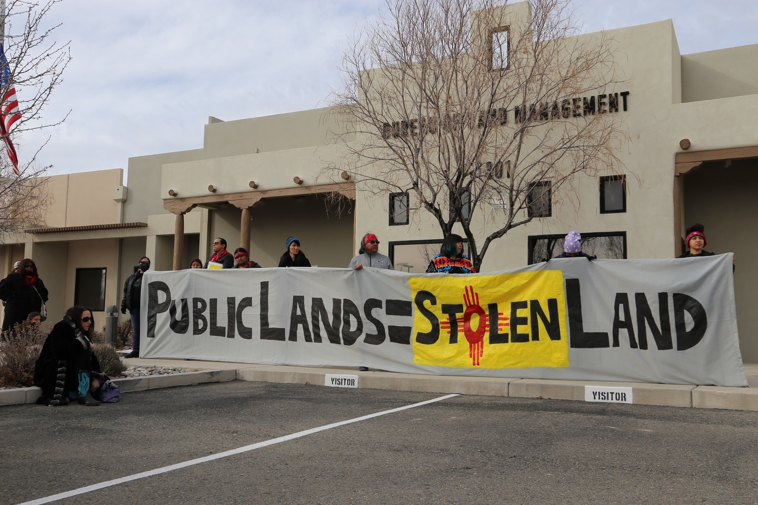 Protesters stood outside the BLM office in Santa Fe today to oppose new oil and gas lease auctioning.