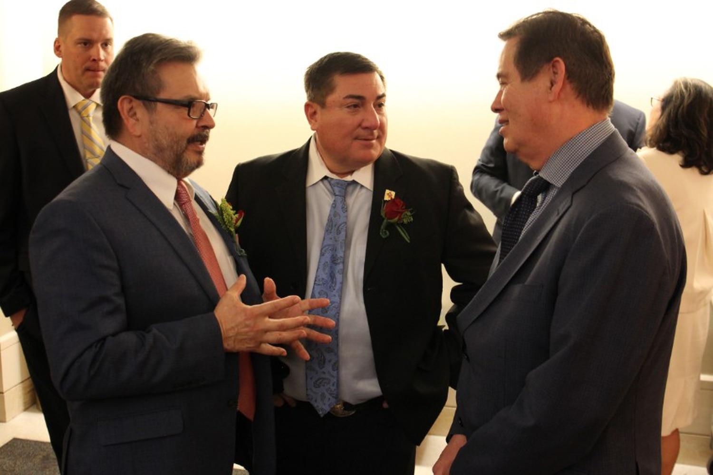 Sens. Carlos Cisneros, D-Questa, and George Muñoz, D-Gallup, speak with Albuquerque City Councilor Ken Sanchez.