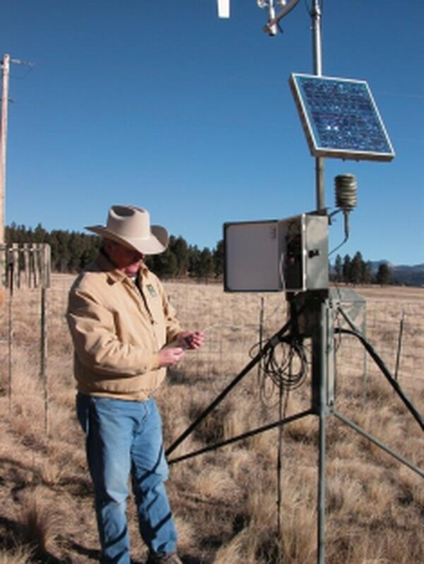 Bob Parmenter, science director at the preserve, checks weather station information in the Valle Grande.Credits: Teri Nolan