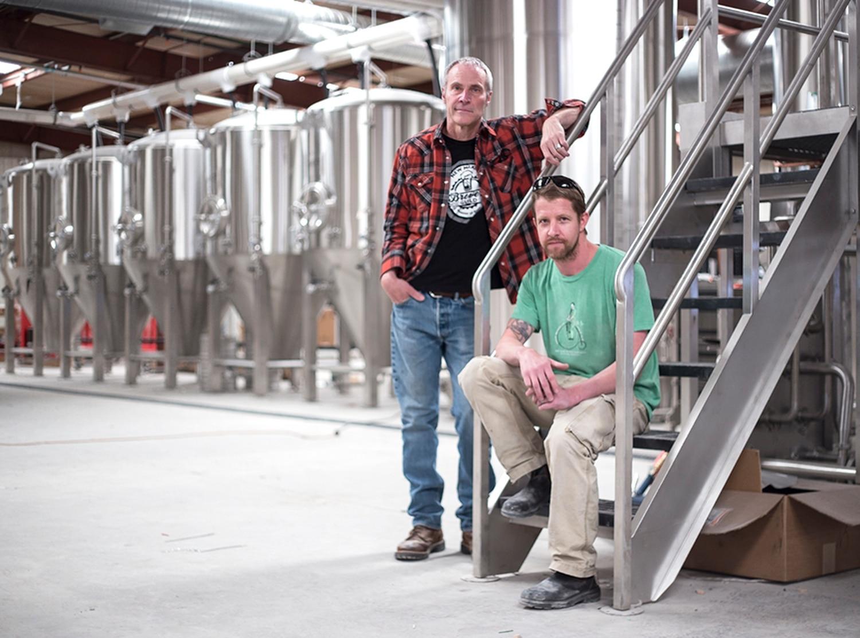 Rod Tweet (left) and John Walker inside the massive new Second Street Brewery warehouse.