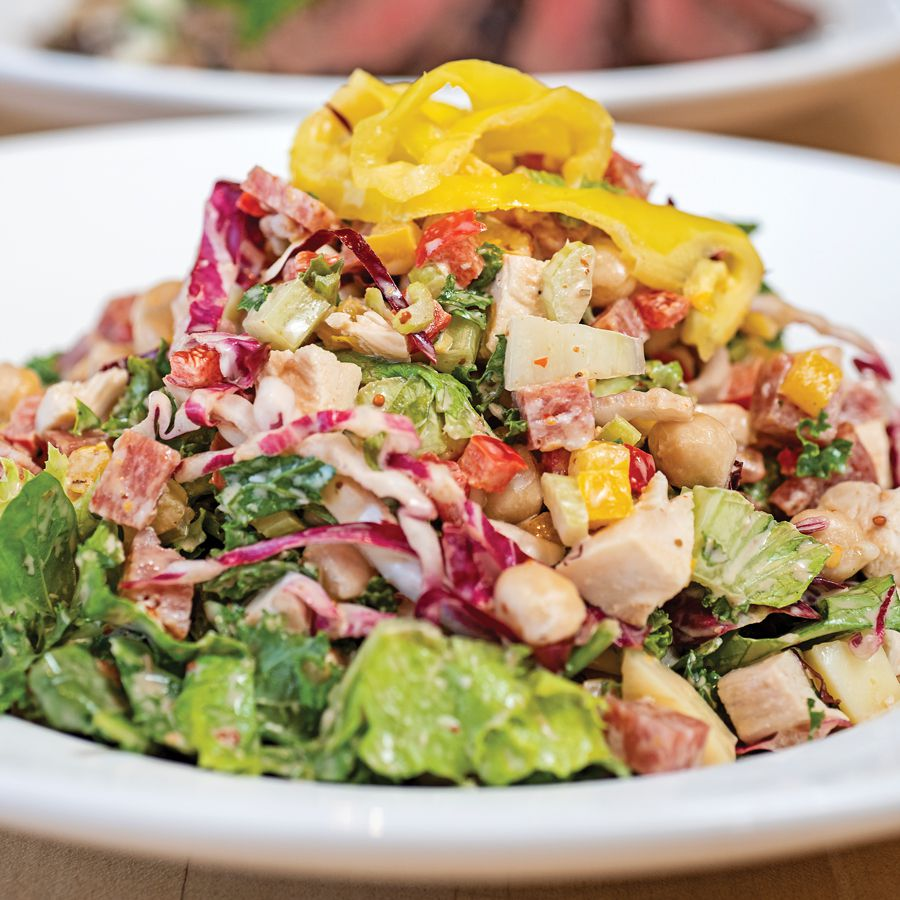 Chop Chop salad with romaine, arugula, a touch of radicchio and kale, with diced celery, cauliflower, bell peppers, tomatoes, chickpeas, salami, herb roasted chicken, provolone and pickled banana peppers