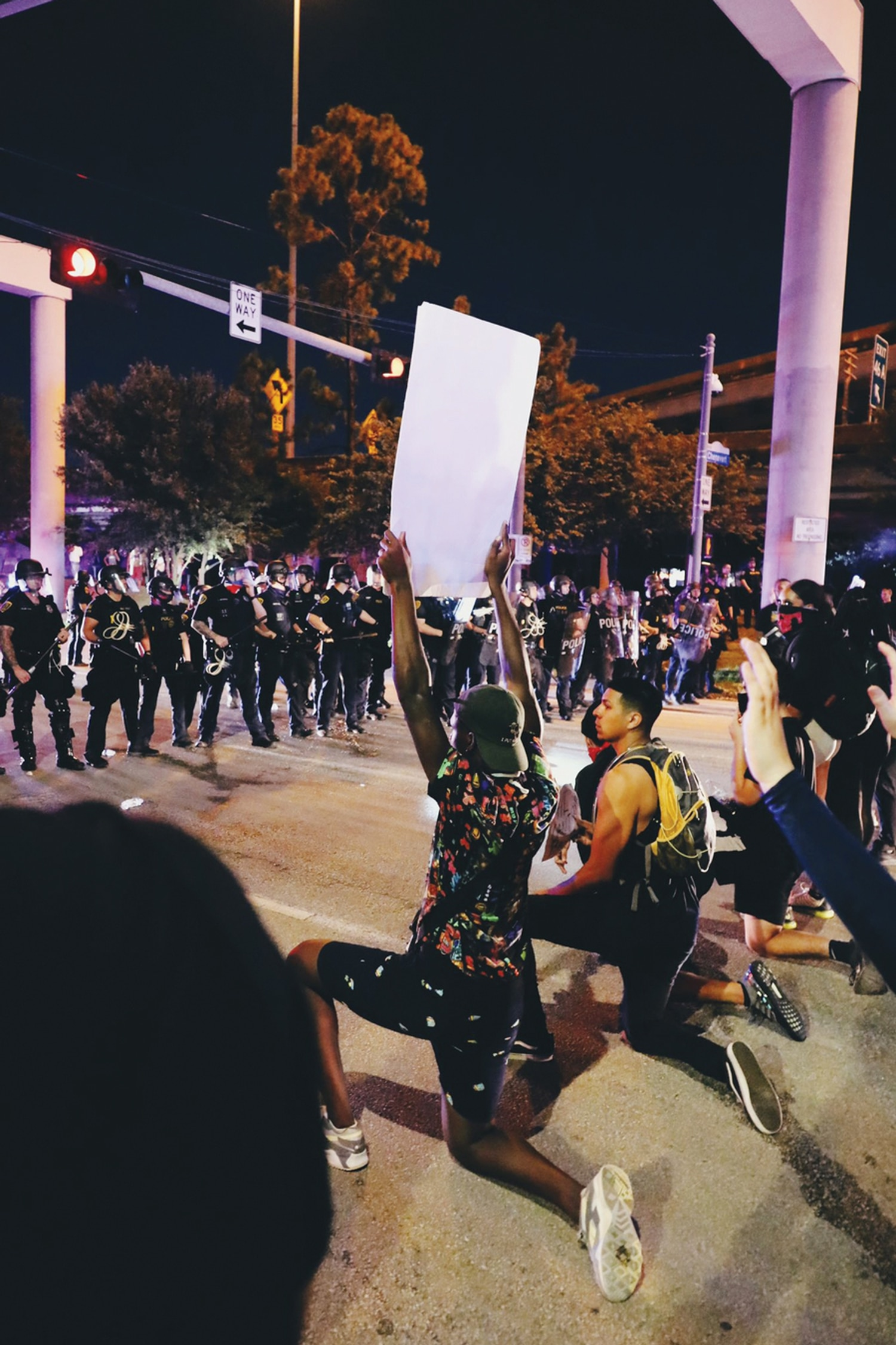 Police meet protesters in the street in downtown Houston on June 2. Later, 200 people would be arrested.