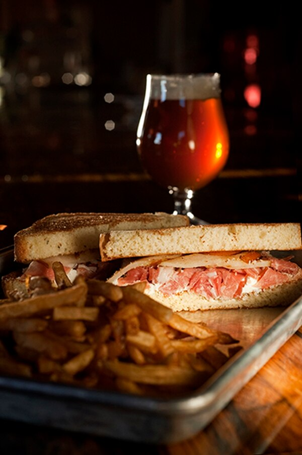 Warm prosciutto pear sandwich with grilled Bosc pear, goat cheese on toasted brioche with fries; Notorious BdG ale