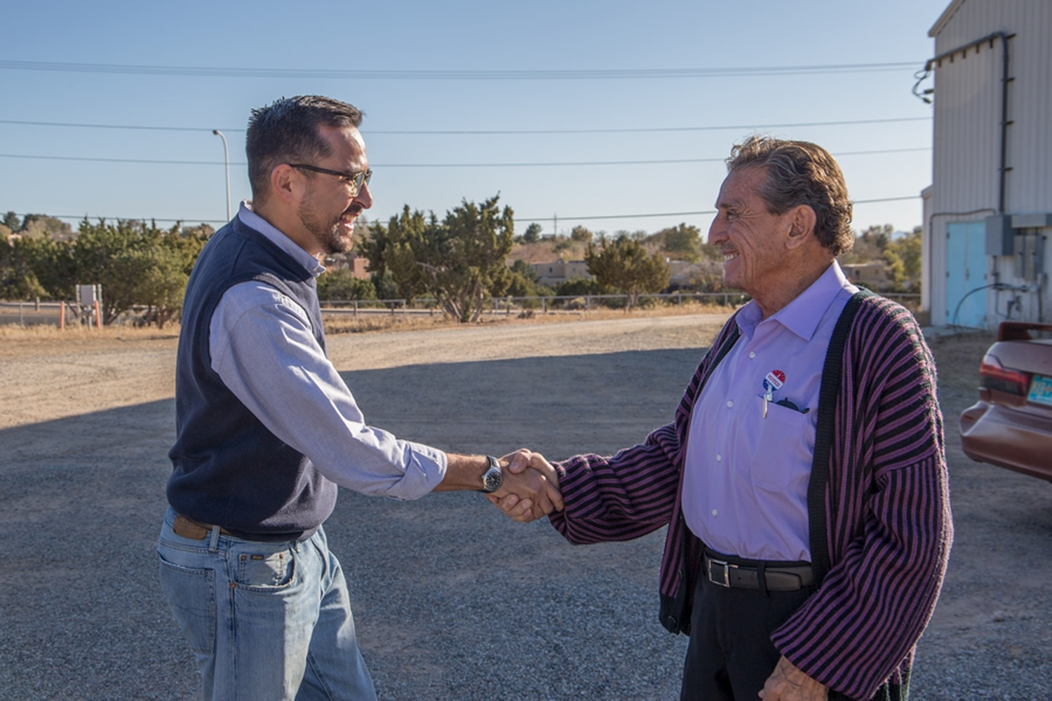 Michael Garcia, who appears to have won the race for District 2, shakes hands with voterTony Lopez.