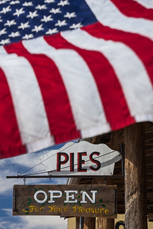 Flag and pies still mark the streets of Pie Town.