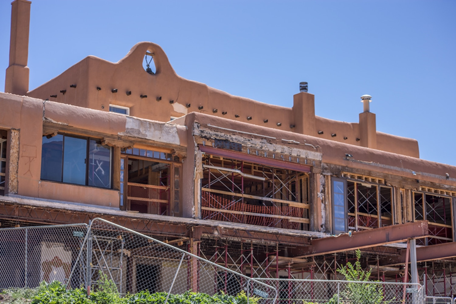 Partial reconstruction left the main lodge building exposed to the elements, and a historic preservationist says the Lamy chapel is likely in danger.