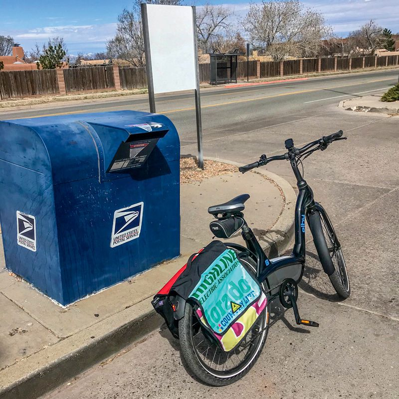Stylin' with an e-bike to deliver the mailed weekly subscriptions to the post office.
