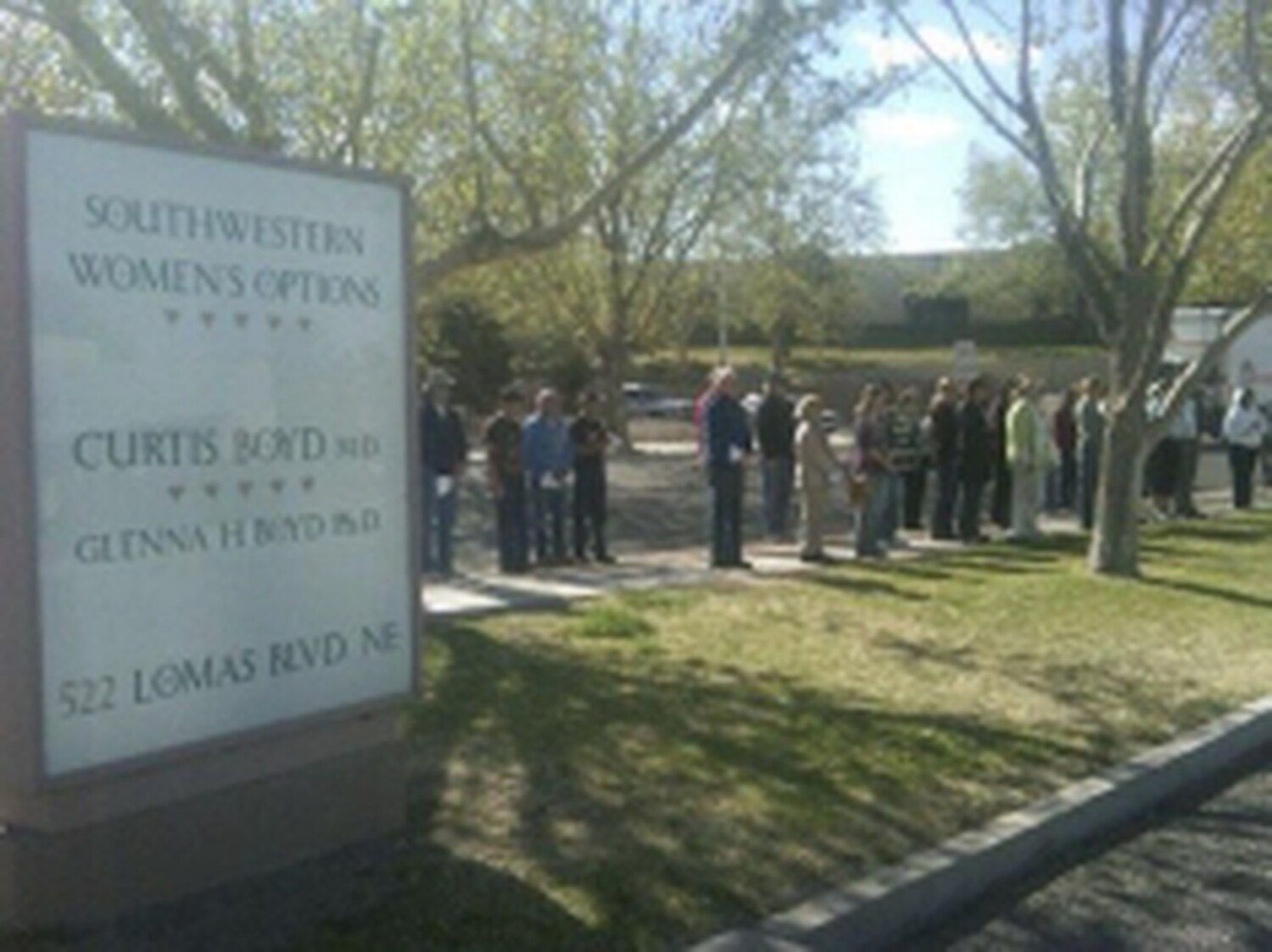 Anti-abortion protesters gather outside another Albuquerque clinic, Southwestern Women's Options.