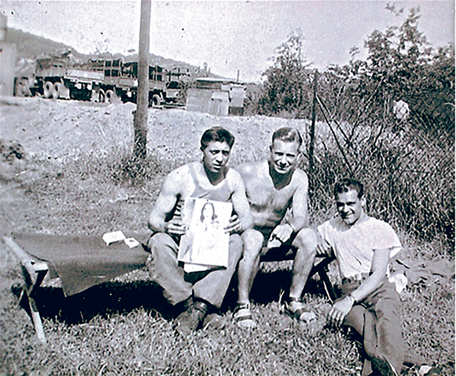 A wartime snapshot shows Angelo's service friends, from left,