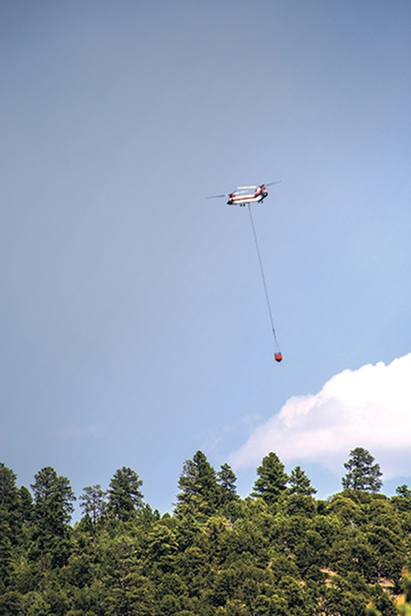 Aerial fire supression efforts help contain what remained of the fire on July 23.