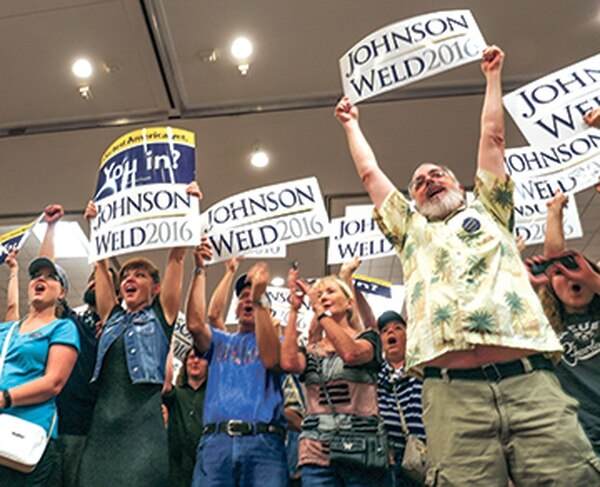 Alfred Walker, far right, is planning to vote for a libertarian candidate for the first time.
