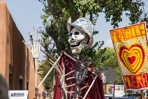 A conquistador puppet with a black heart was part of the demonstration.