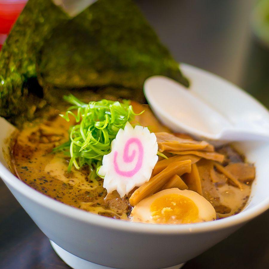 Vegan miso ramen with shitake, kombu veggie broth, bamboo shoots, roasted cabbage and peppersand fried tofu