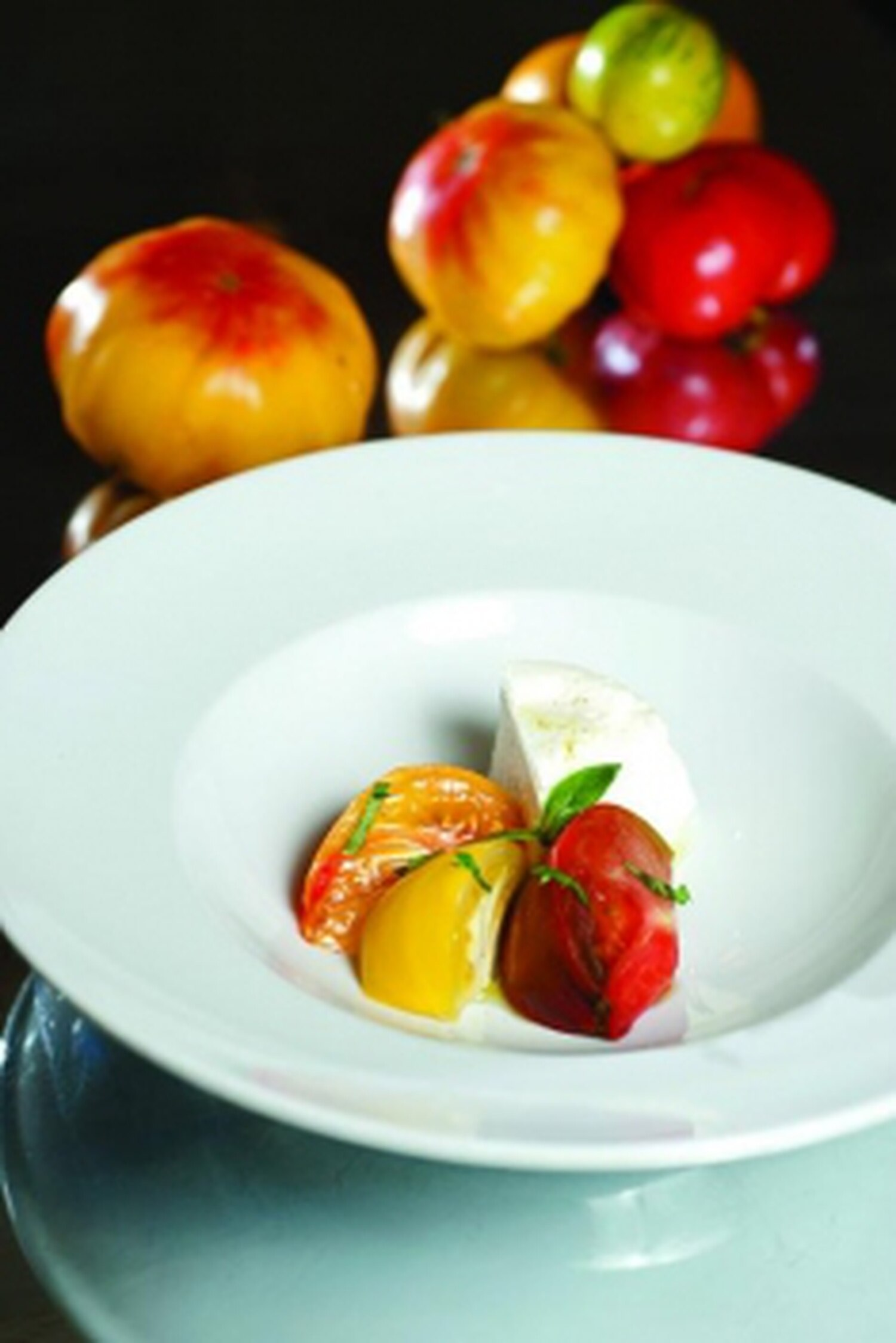 Burrata with heirloom tomatoes, basil and extra virgin olive oil Photo: Joy Godfrey