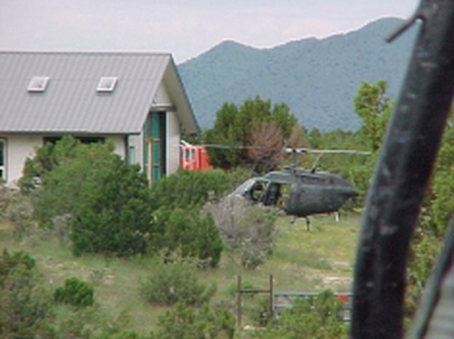 John Smith took this photograph of a National Guard helicopter parked near a Madrid home during a 2006 eradication mission.Credits: Photo courtesy of John Smith