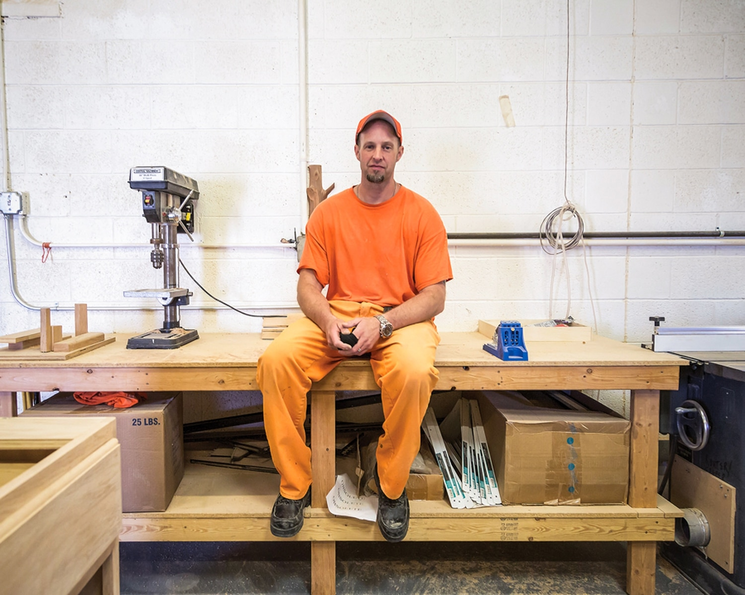 Allen Rackley, an inmate at the Central New Mexico Correctional Facility in Los Lunas, pauses from building a reception desk destined for Buffalo Thunder Resort & Casino. He is one of about 40 inmates who work inside the prison's furniture shop.