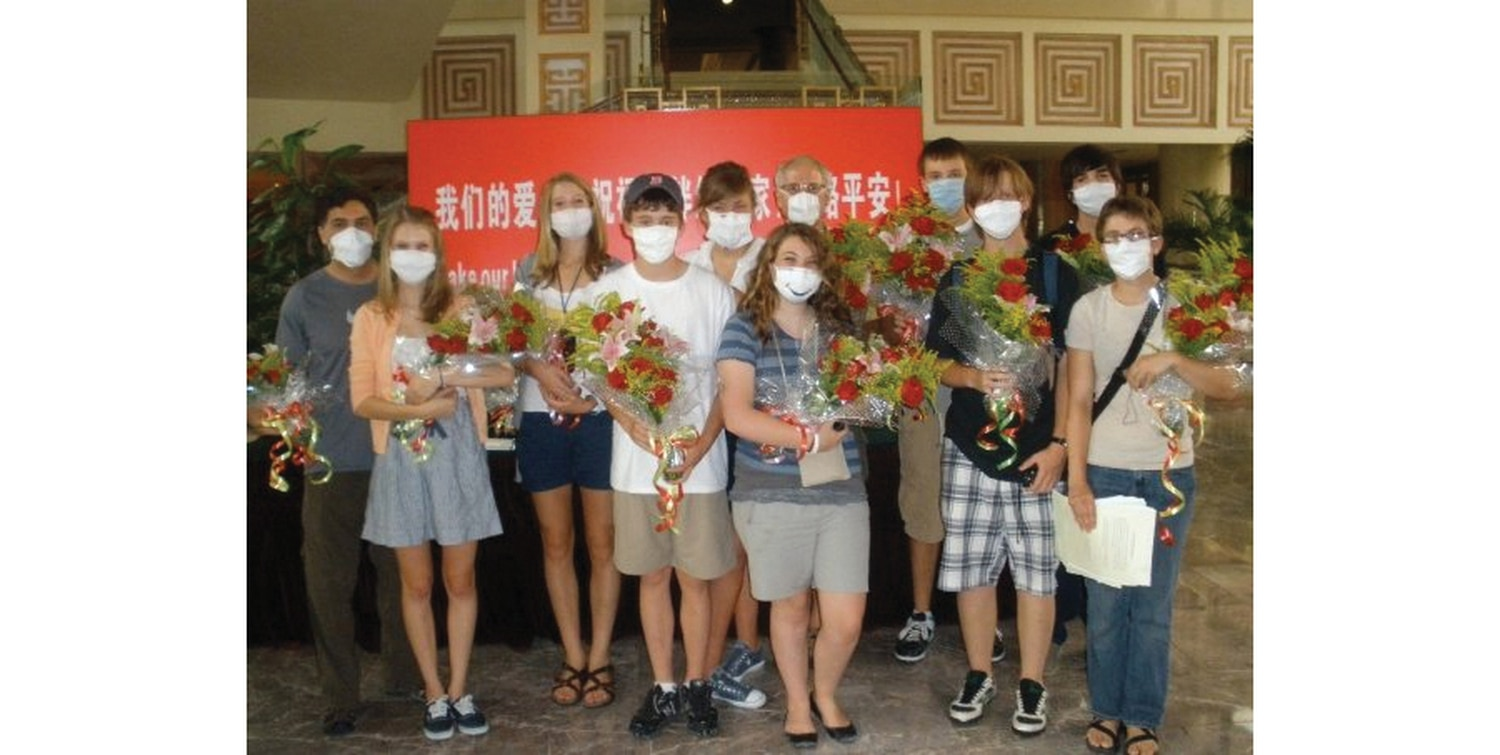 Students from Santa Fe Prep pose with flower boquets from the Ministry of Health after being released from quarantine in China. The author is fourth from the left.