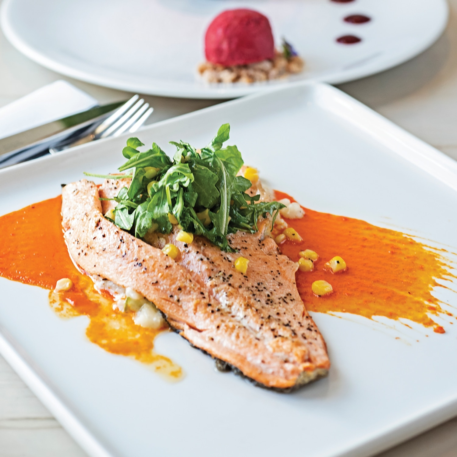 Ruby red trout with pan fried trout, Peruvian pepper sauce, calabacita risotto and arugula