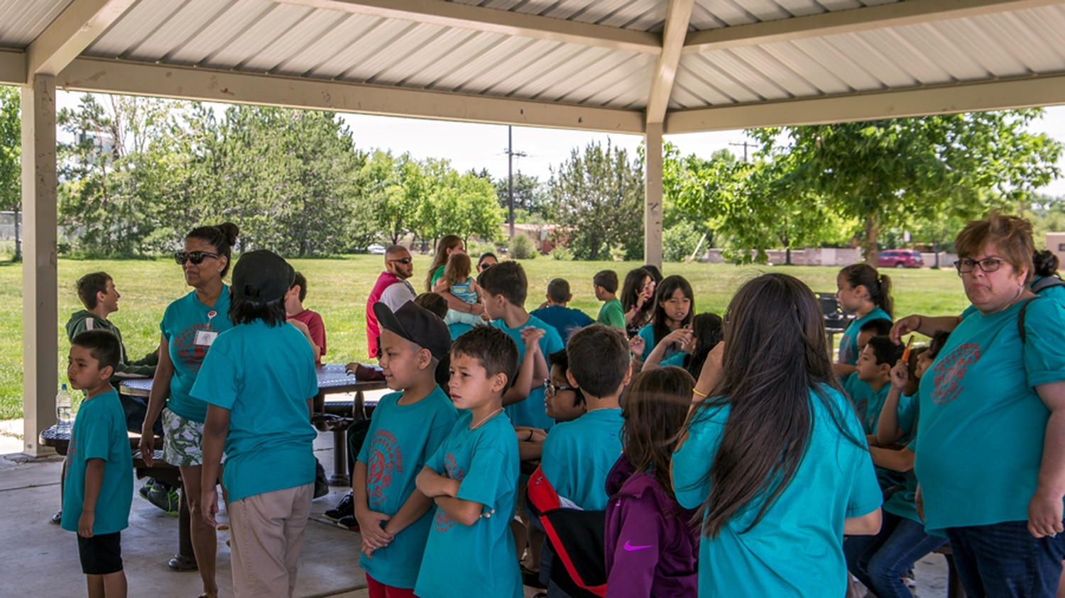 Students from the Kha'p'o Community School summer school program get free lunch during Santa Fe field trip.
