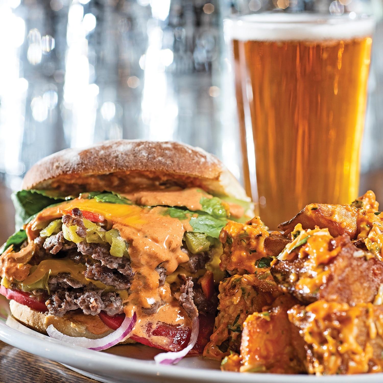 The Skinny Burger Served with red patatas bravas