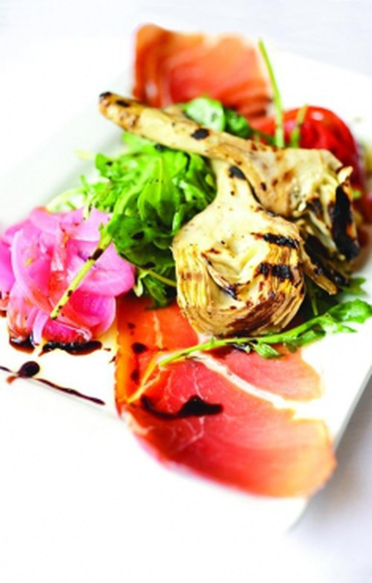 Grilled artichoke salad with arugula, jamón serrano and aged sherry vinegar reduction Photo: Joy Godfrey