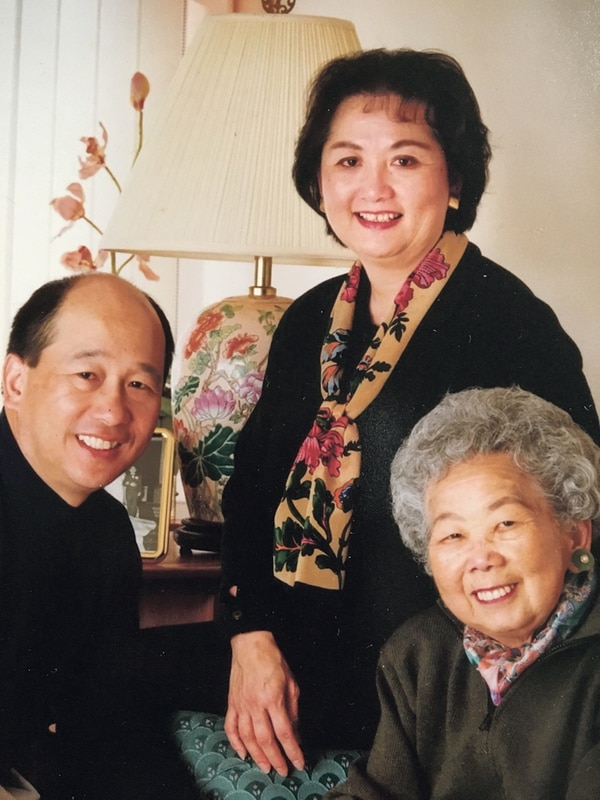 George Lim and Sue Lim sit for a family portrait with their mother, Yon Shee Park.