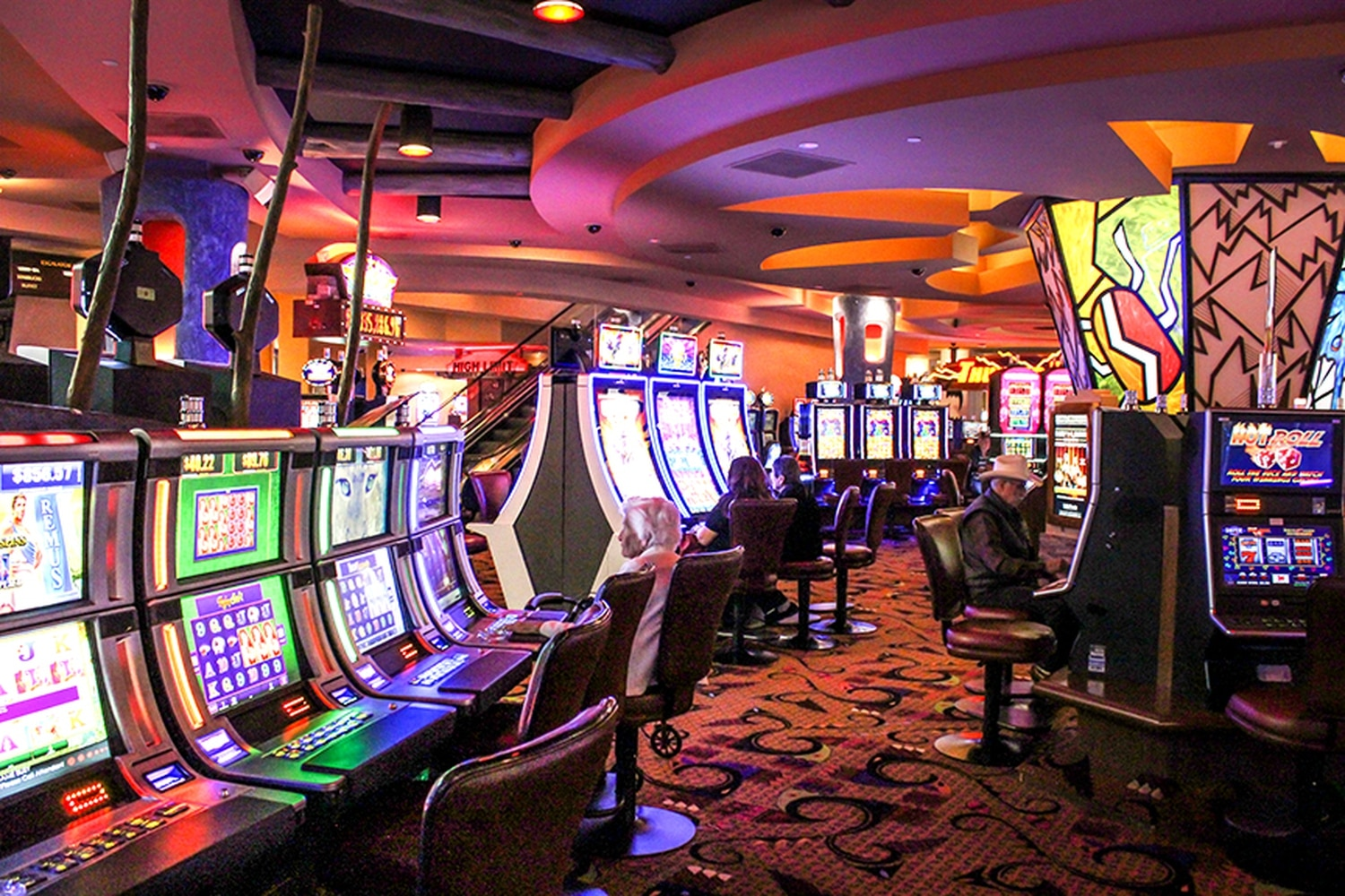 Gamblers test their luck at the slot machines at Buffalo Thunder, one of Pojoaque's two casinos.