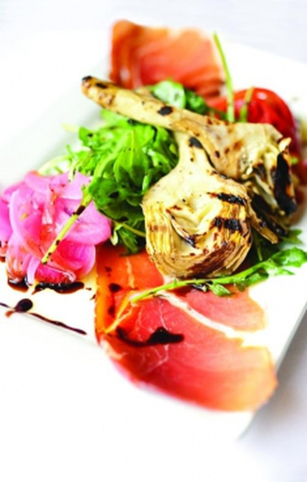 Grilled artichoke salad with arugula, jamón serrano and aged sherry vinegar reduction Photo: Joy Godfrey