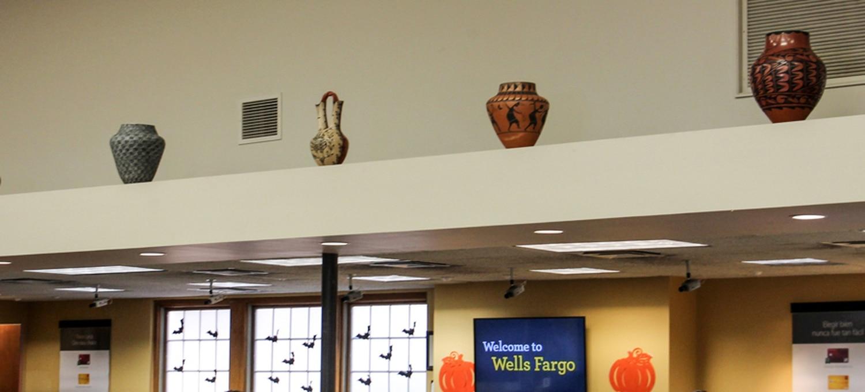 Pots on ledge inside of bank.