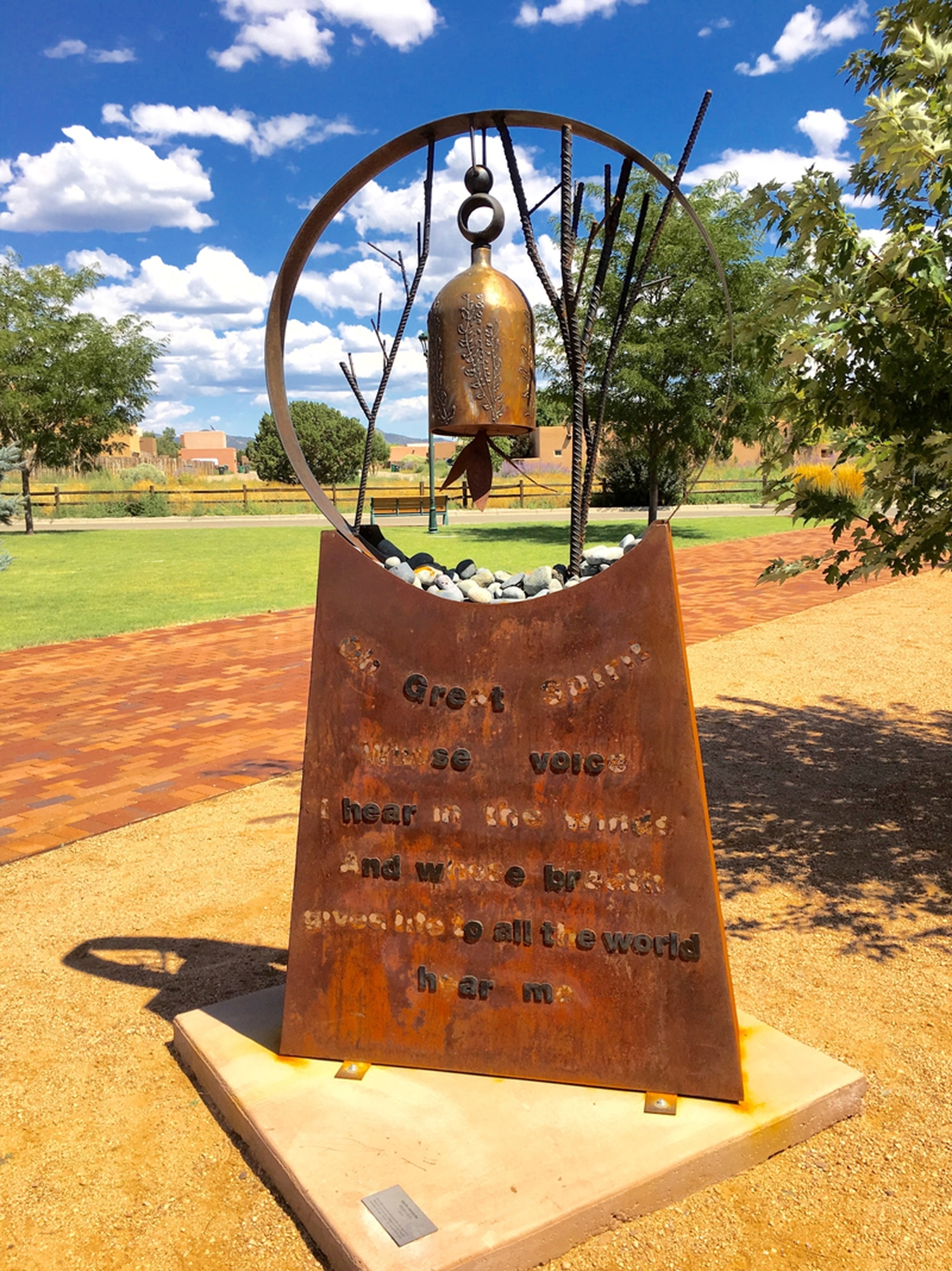 Words from a Lakota Sioux prayer were removed from the sculpture and scattered across Oshara Village Plaza | Courtesy of Sara Miller